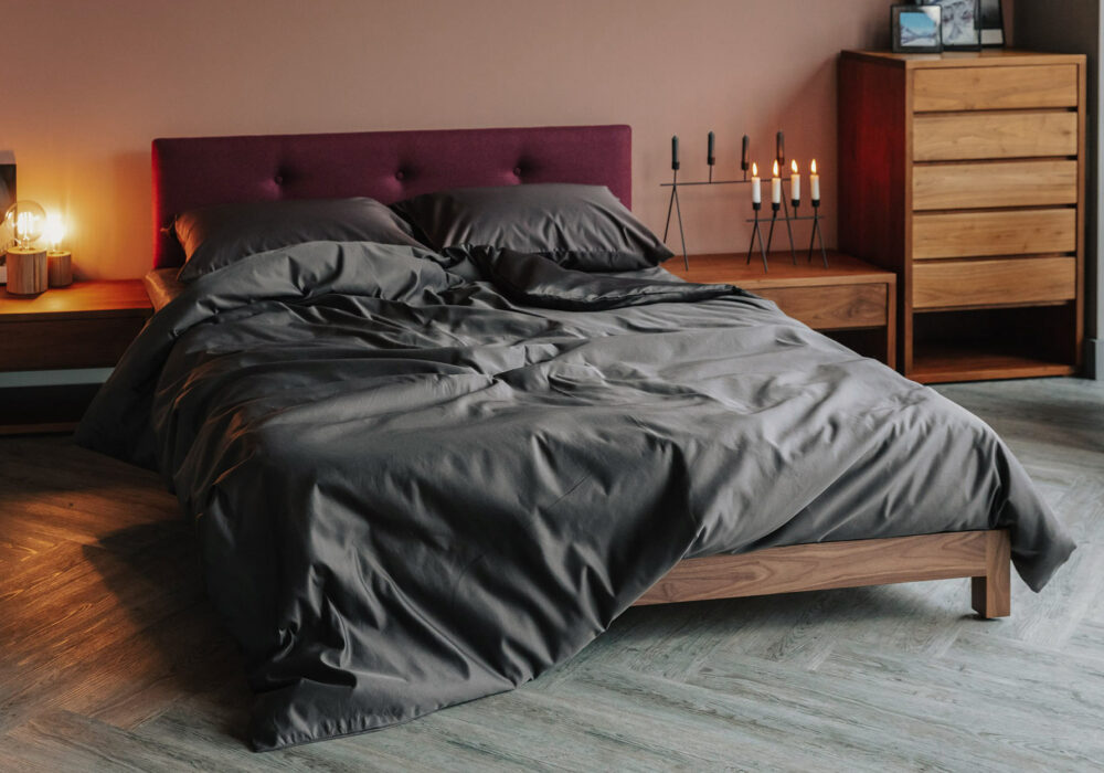 Draped luxury cotton bedding shown on our low upholstered Iona wooden bed