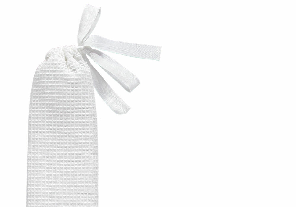 YuYu long thin therapeutic hot water bottle with white waffle cotton cover