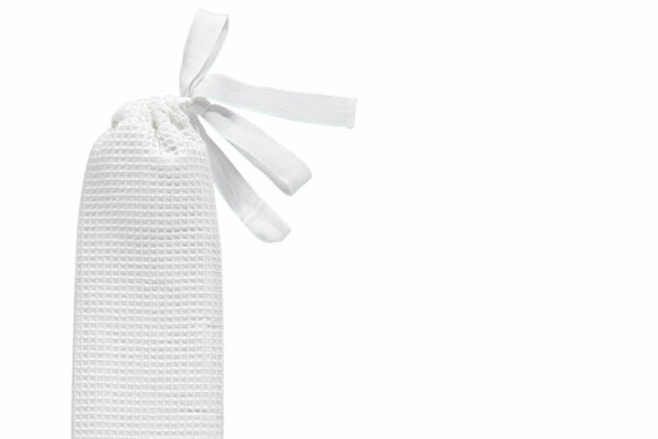 YuYu hot water bottle with white waffle cover