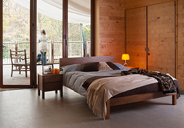 Rustic country bedroom setting for our solid Walnut Sahara bed