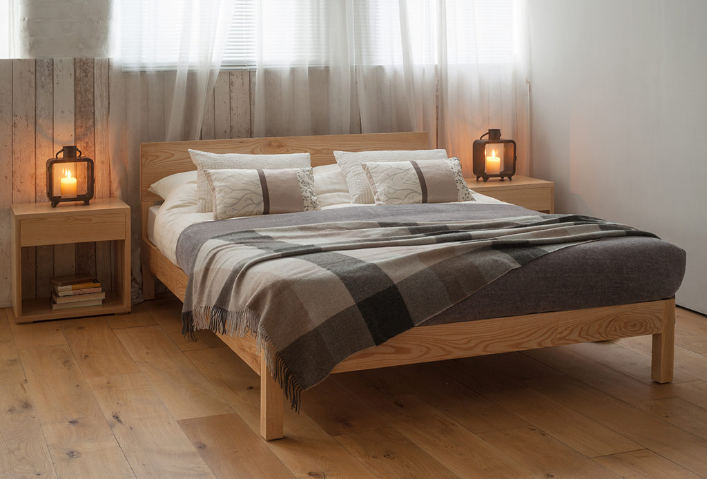 Sahara wooden Bed made from solid Ash is shown with Cube bedside tables in matching Ash wood.