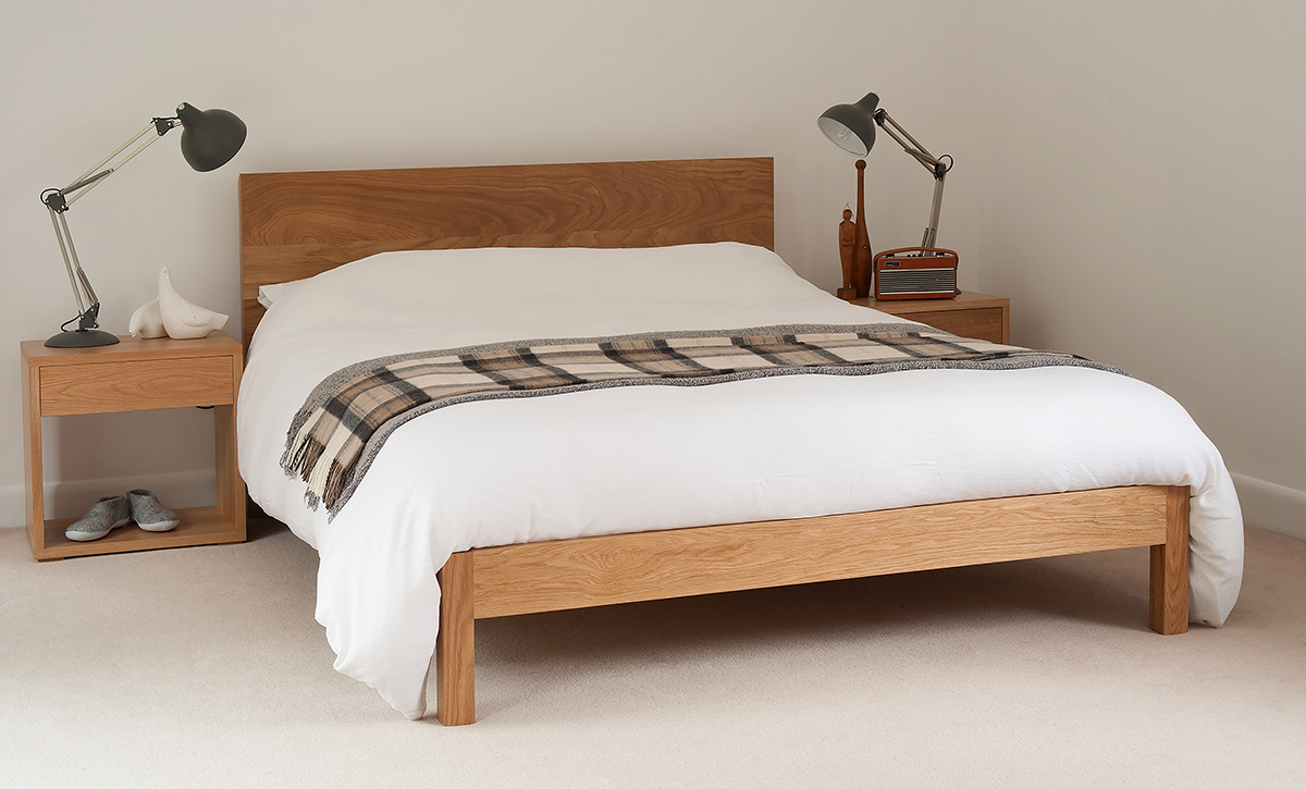 A contemporary solid wood bed the Malabar, designed and made by natural bed company