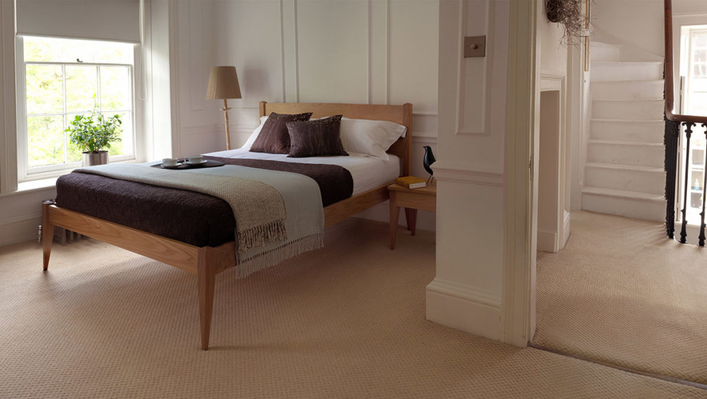 A traditional Georgian bedroom features our Oak Cochin Bed and bedside tables.