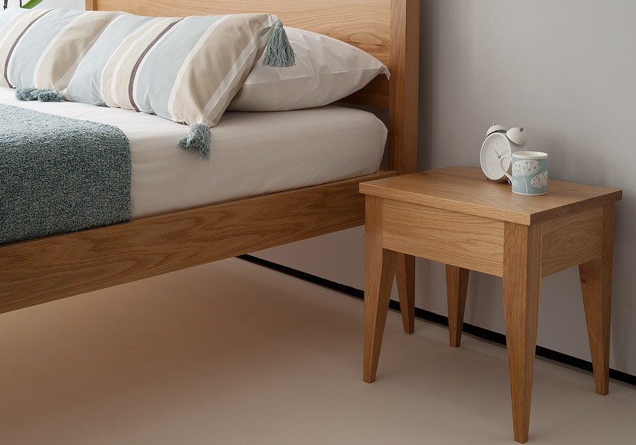 Cochin wooden bed with matching Cochin table here shown in Oak