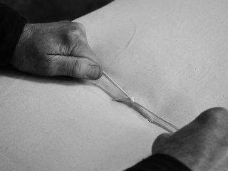 Hand tying the cotton threads in our futon mattress
