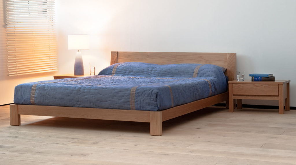 Java a contemporary low wooden bed in solid oak