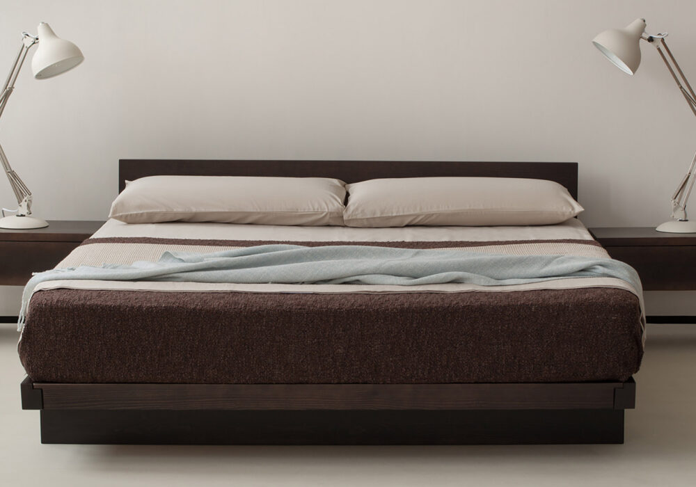 Kumo low wooden bed shown with matching Kyoto drawer tables