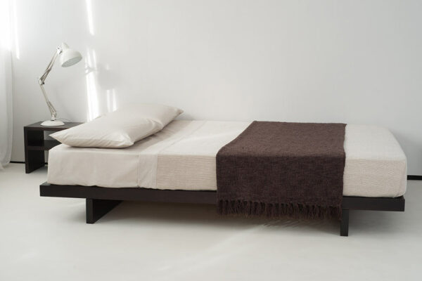 Contemporary low wooden platform bed