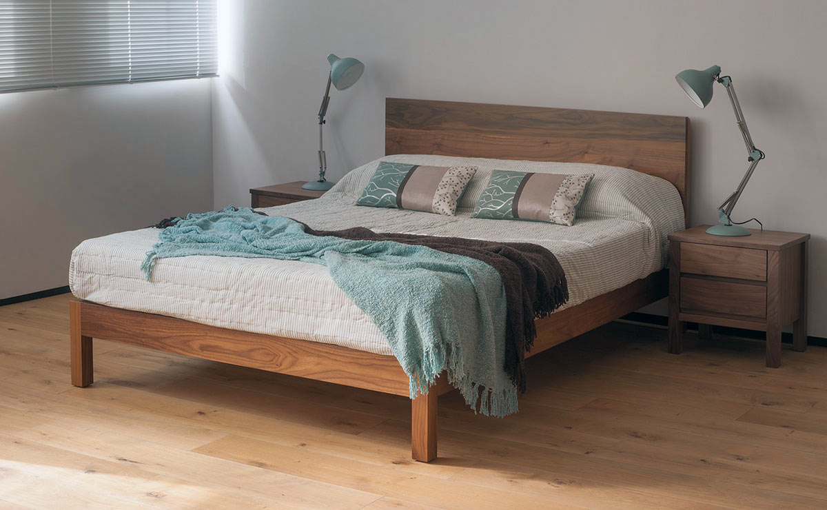 Malabar contemporary solid wooden bed shown here in Walnut