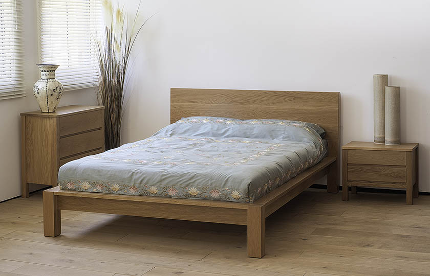 Ocean Contemporary wooden bed in Oak shown with Oak Shaker storage chests