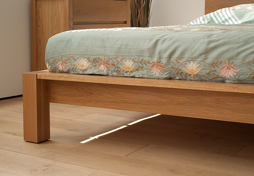 A closer view of the leg and frame of our Ocean Contemporary wooden bed in Oak