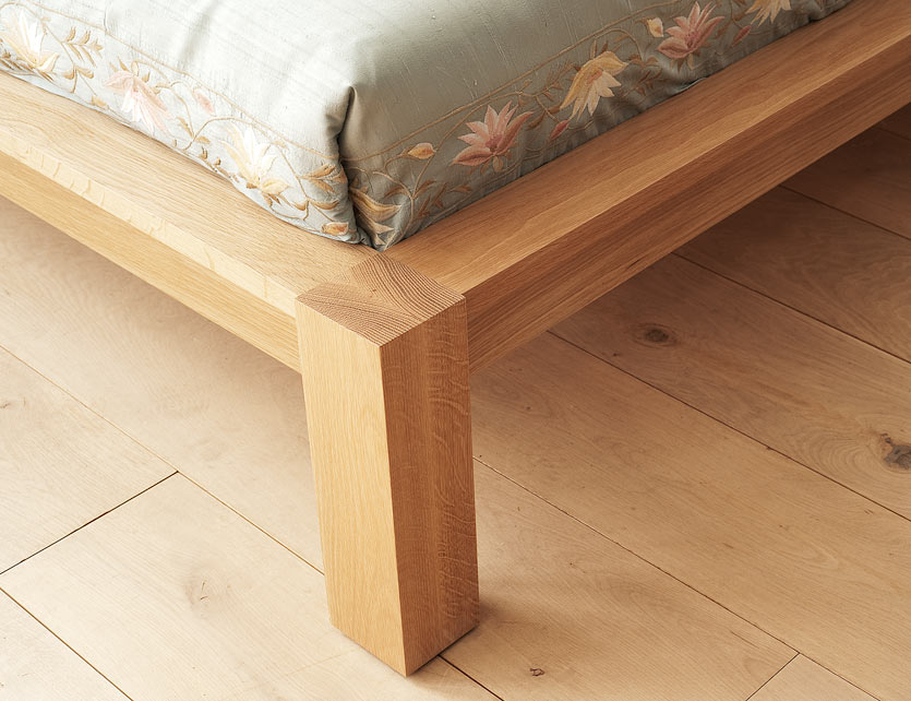 A closer view of the leg of the Ocean Contemporary wooden bed