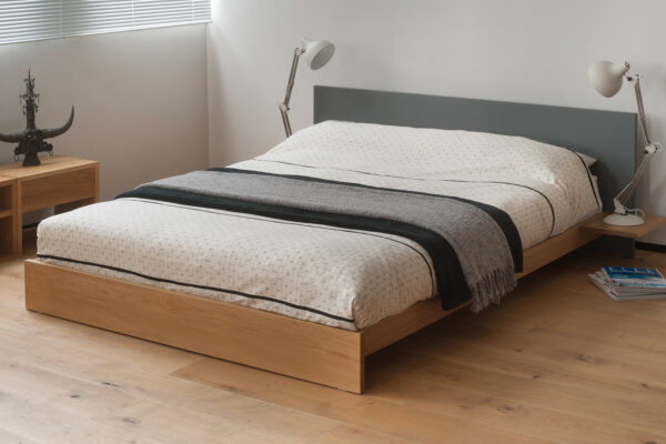Koo is a low platform style bed with optional side tables and painted headboard