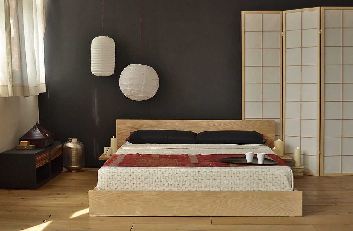 A Bedroom with an Oriental look featuring the low wooden Kulu bed made from solid Ash wood.
