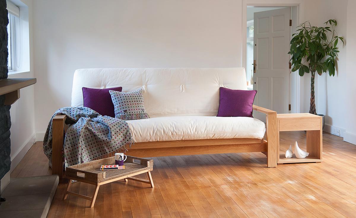 Cuba a futon sofa bed available in Oak or Walnut