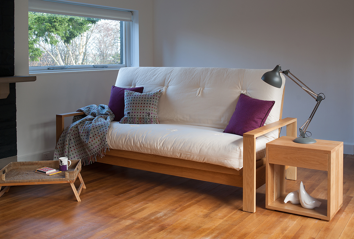 Cuba a futon sofa bed available in Oak or Walnut