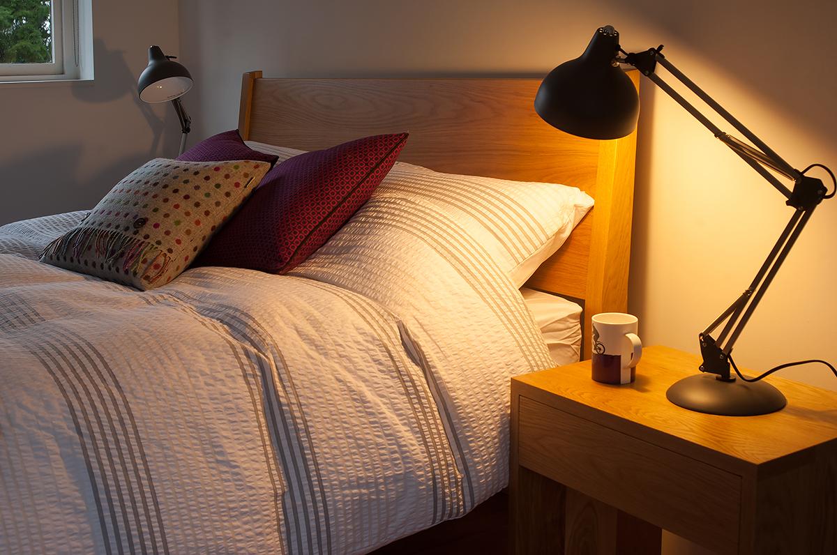 A closer view of our wooden Zanskar bed headboard made from Oak.