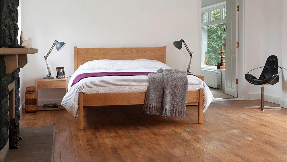 Classic wooden Zanskar taller bed in Oak with Cube bedside tables.