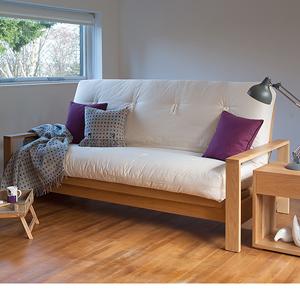 Cuba luxury sofa bed in Oak with a futon mattress shown in sofa position