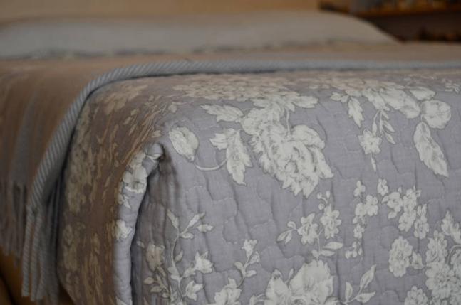 powder grey floral quilt