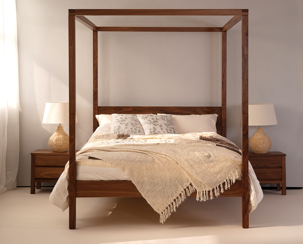 orchid a solid wood contemporary four poster bed shown in Walnut with Walnut Shaker Bedside drawers