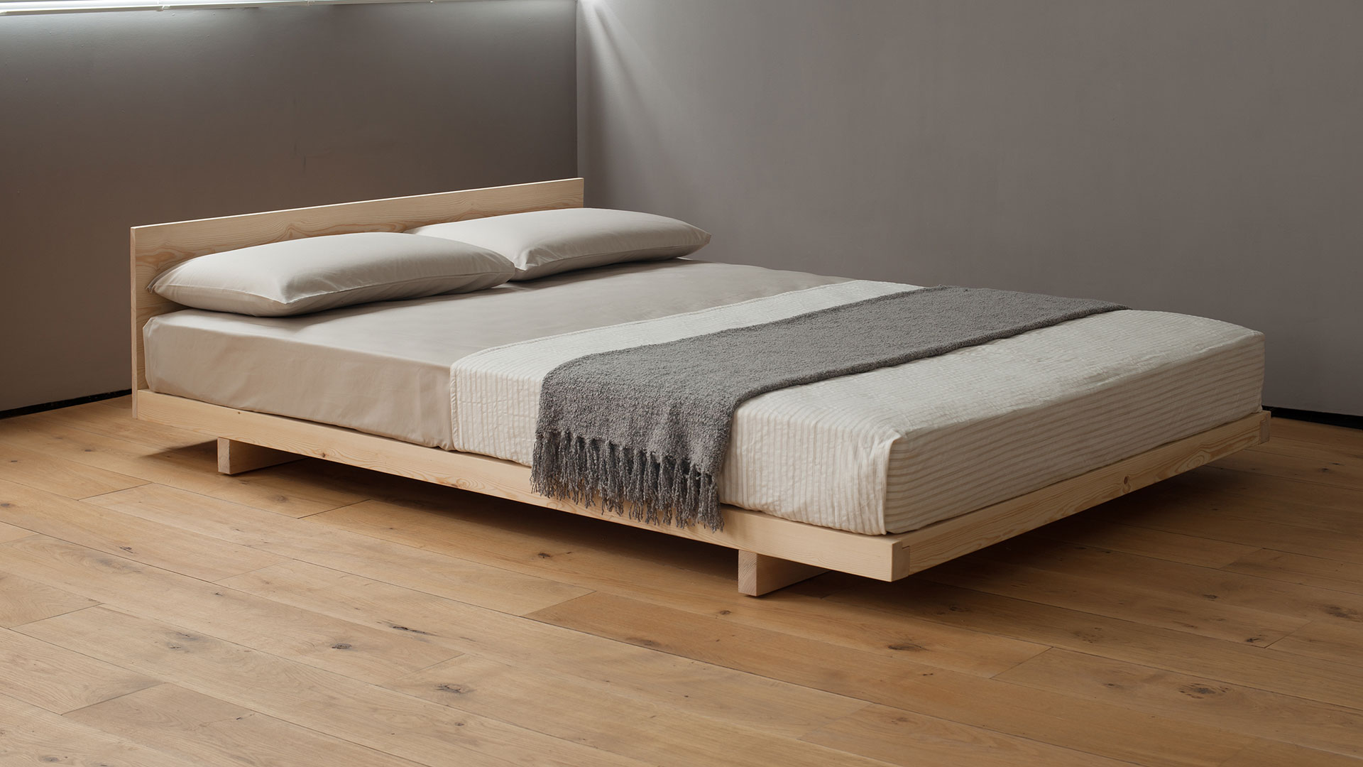 Kobe is an ultra low wooden bed or futon base which comes with or without a headboard