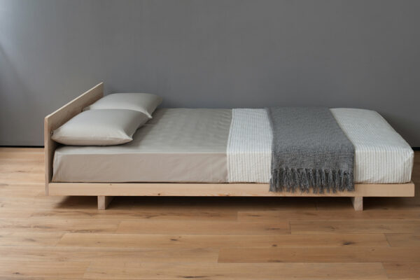 Kobe a low wooden Japanese style bed or futon base shown with a headboard
