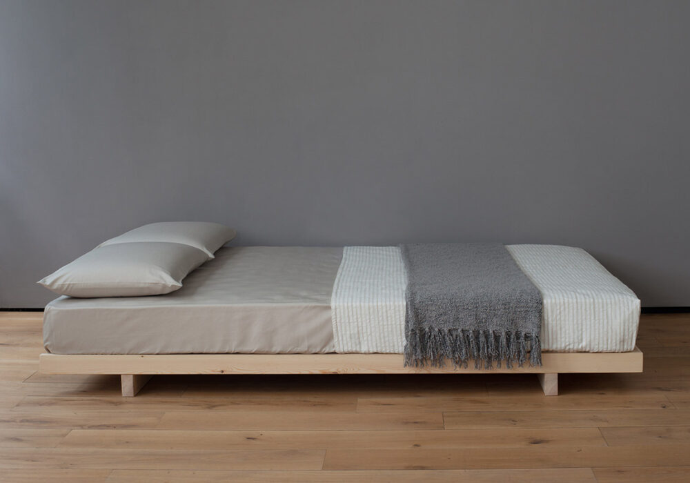 Japanese style low beds wooden Kobe bed or futon base shown without headboard