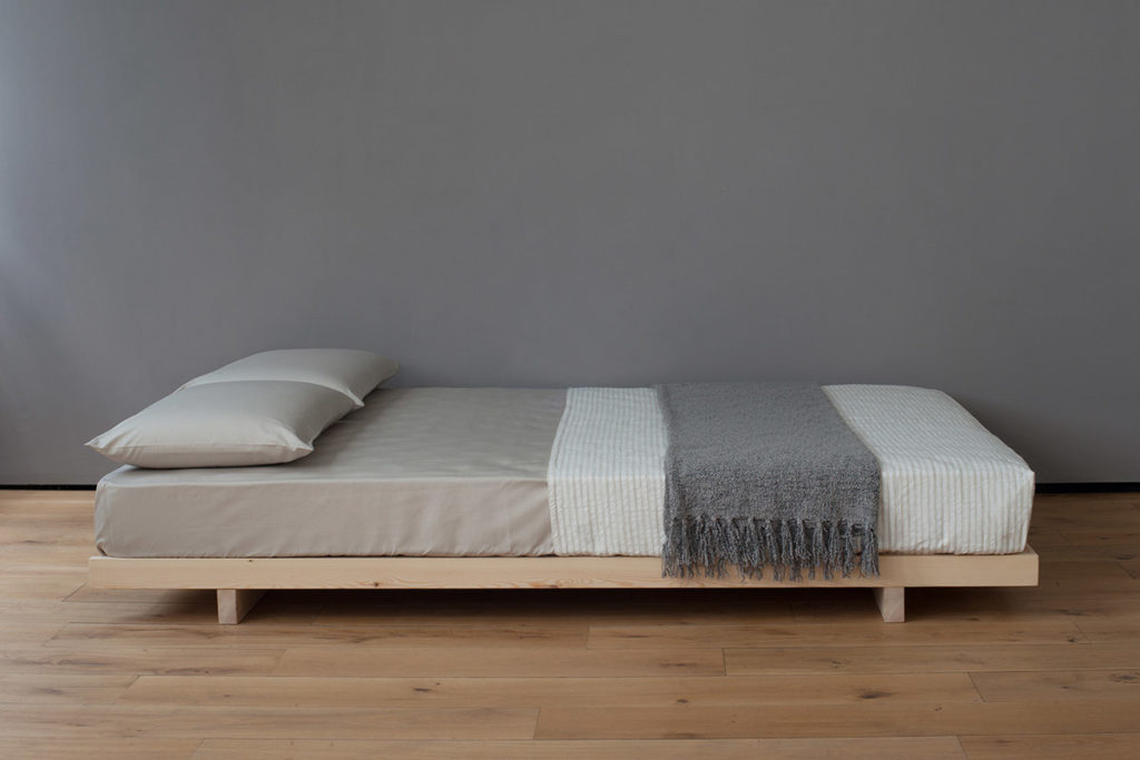 Japanese style low wooden Kobe bed or futon base shown without headboard