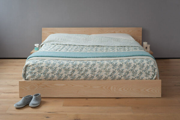 Our Kulu bed is a solid wooden platform style low bed with optional shelf tables attached