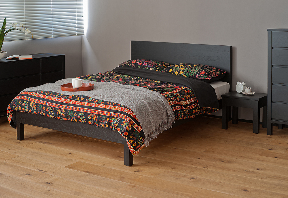 Exotic bedding on our Black Malabar wooden bed