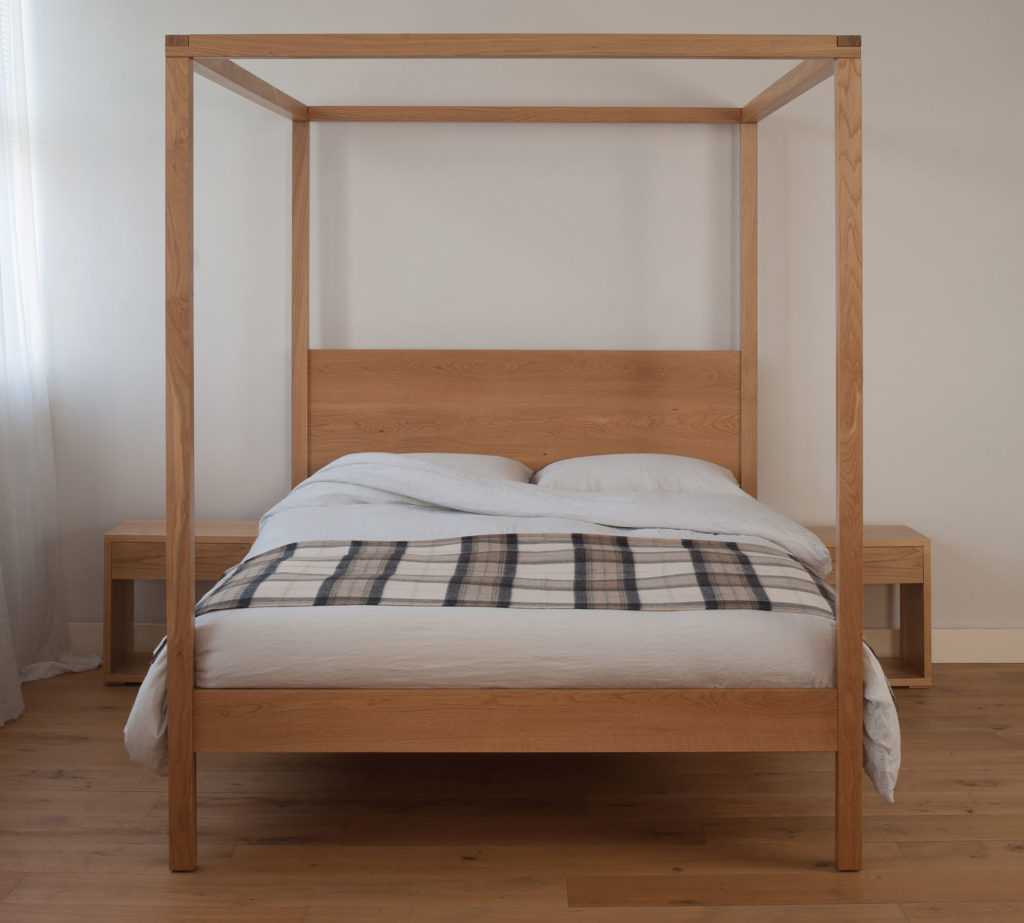 A contemporary uk made four poster bed made from solid wood the Orchid here is in oak