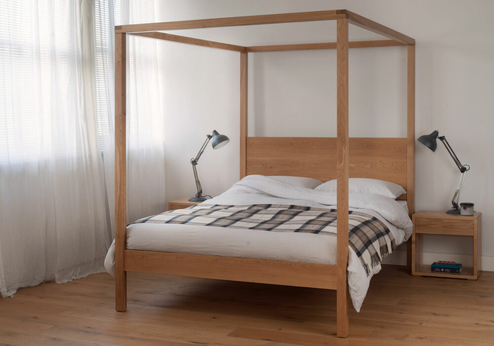 Orchid wooden four poster bed in oak shown with matching Oak Cube bedside tables