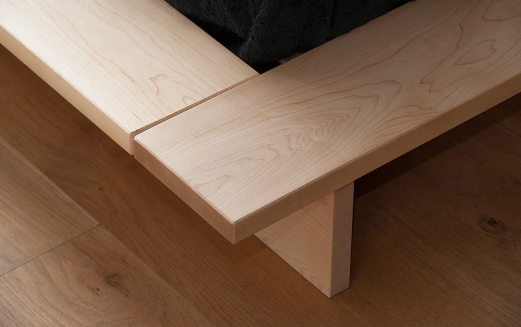 A closer view of the platform frame and leg of the Oregon solid wood low bed
