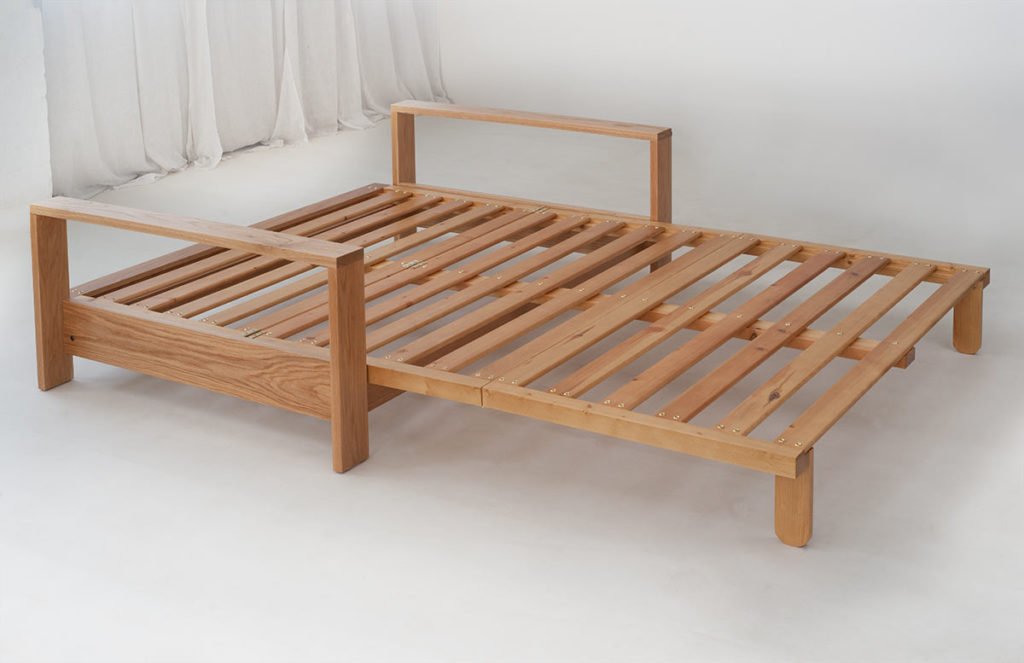 Panama Oak framed futon sofa bed, shown in the bed position and without a futon mattress