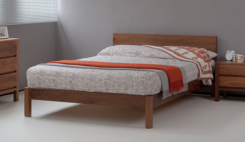 Walnut bedroom furniture including the Sahara contemporary wooden bed and Shaker storage chests