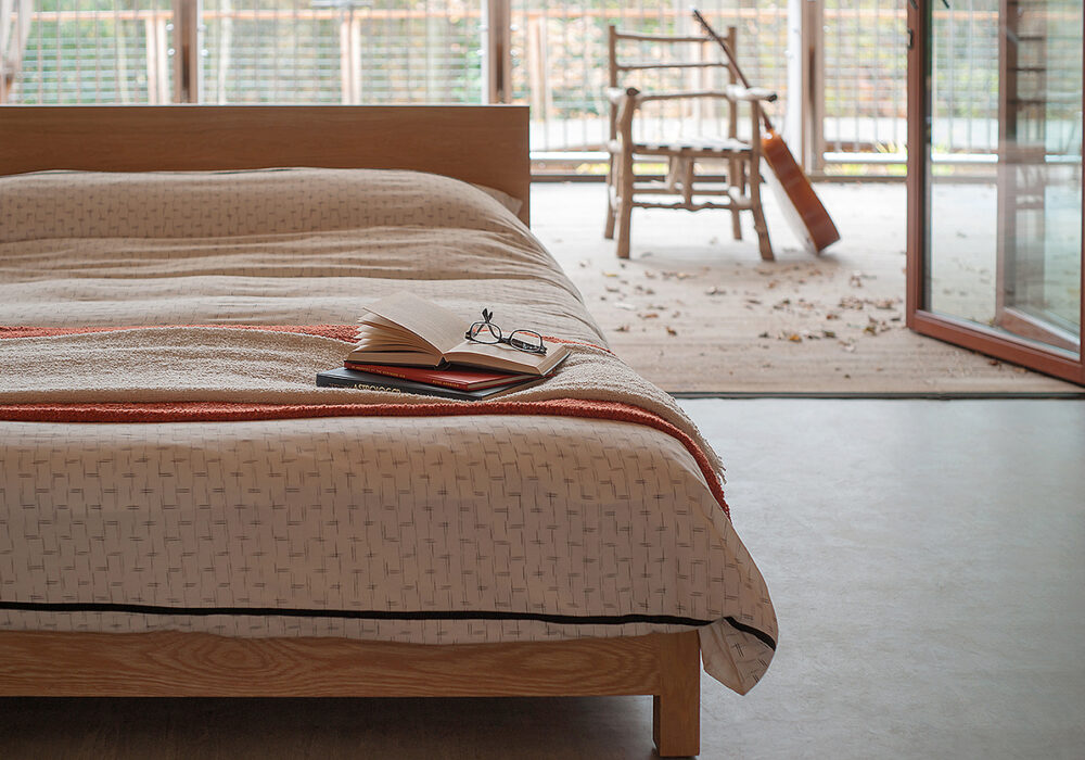 Sonora a contemporary low wooden bed in solid oak