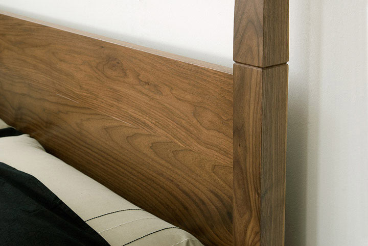 A closer look at the exotic Togo wooden bed headboard in walnut