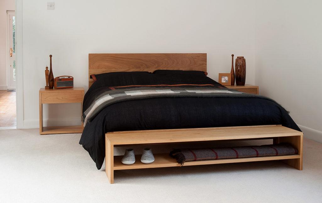 Scandinavian look solid oak modern malabar bed shown with Cube bedside table & oak storage bench