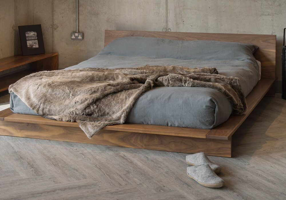 Loft style bedrooms, the low wooden platform bed, the Oregon shown in Walnut wood