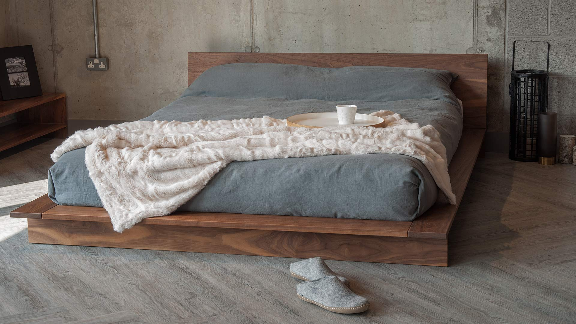 Low Japanese style solid wood bed The Oregon, here in walnut but available to order in a choice of wood