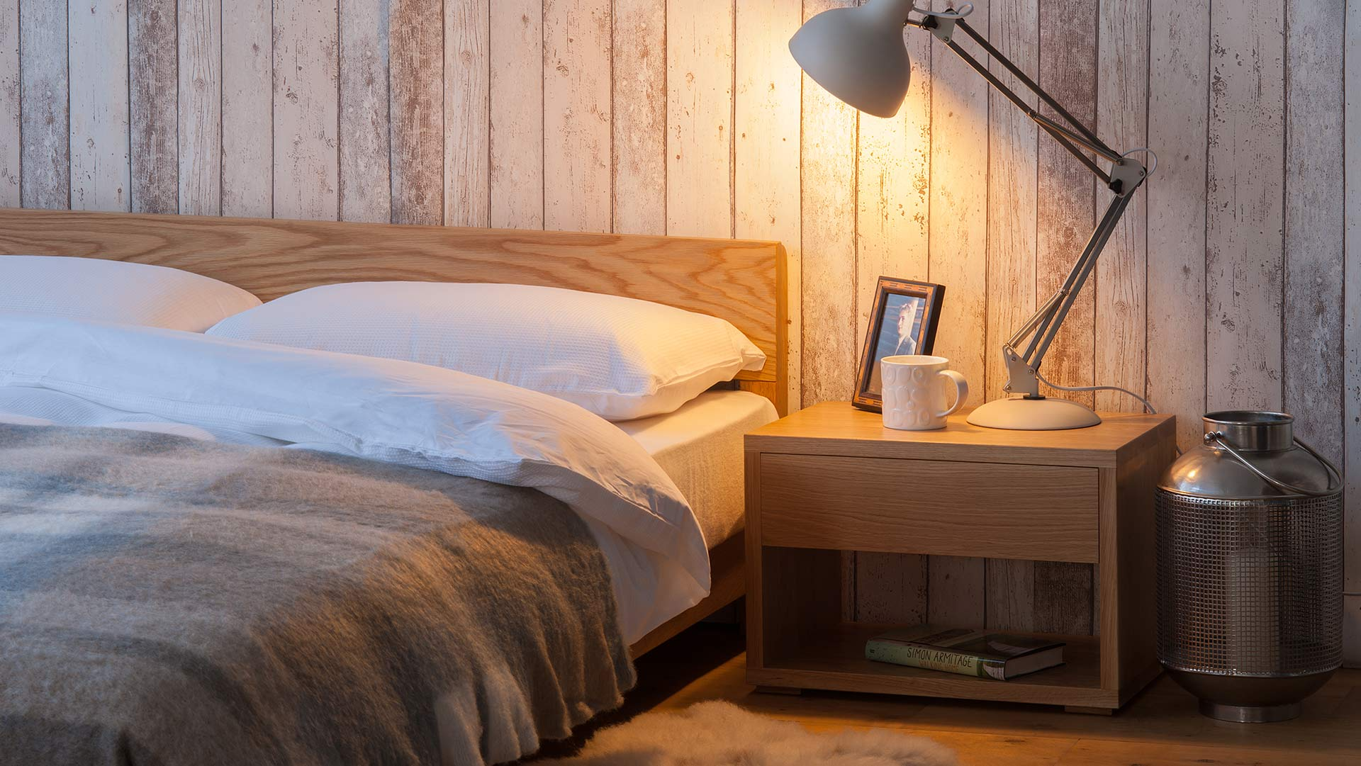 Our Sheffield made oak Nevada bed with matching low Cube bedside table.