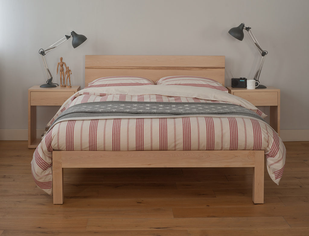 Modern solid wood Tibet bed with New England style bedding and Cube bedside tables.