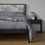 Charcoal linen bedding and cosy blanket on black oak Shetland bed