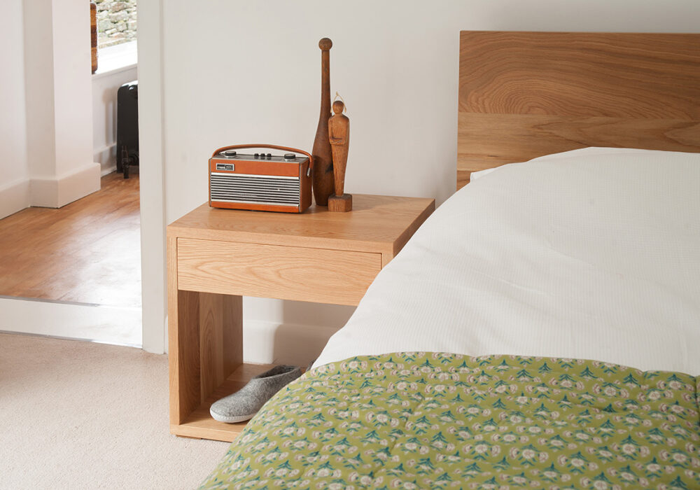 We hand make our Cube bedside drawer tables in Britain, in a choice of wood and in 3 size options.
