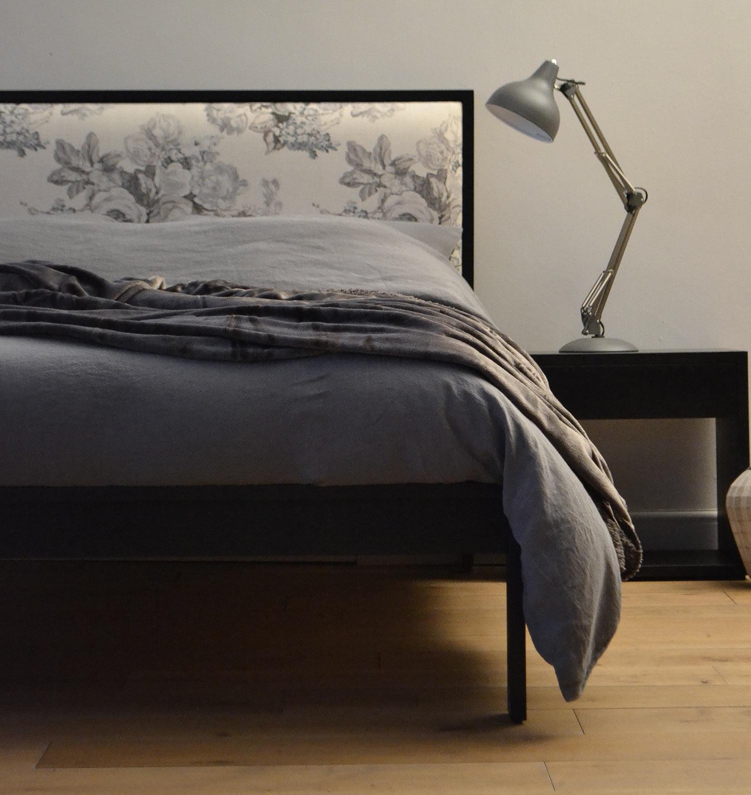 grey linen bedding on black painted oak shetland wooden bed