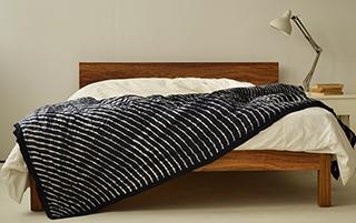 Sahara low wooden bed in bespoke choice exotic hardwood