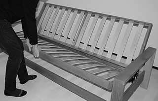 Cuba wooden futon sofa bed base shown without mattress.