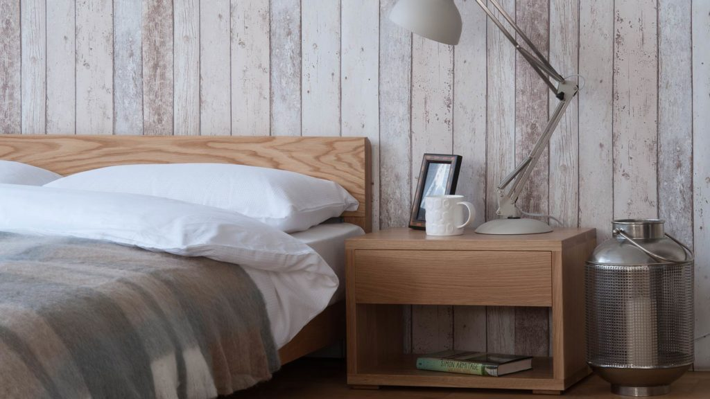 Oak Nevada low wooden bed shown with Cube bedside table also in Oak