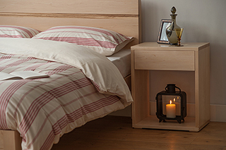 Maple Tibet Bed with matching Maple tall Cube bedside table. All made by us in UK.
